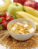 Cereal corn flakes and fruit ingredients background — Stock Photo