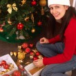 Stock Photo: Beautiful young woman with Christmas tree,Decorating Christmas tree