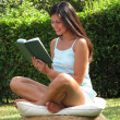Outdoors reading book woman. — Stock Photo