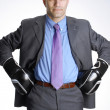 Businessman with boxing gloves isolated on white background — Stock Photo