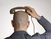 Rear view from annoying bald head man on phone. — Stock Photo