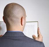 Optimistic businessman holding a newspaper — Stock Photo