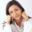 Fresh and happy latin woman portrait in white sweater. - Stockfoto