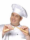 Cook tasting bread sticks,happy chef portrait. — Stock Photo