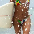 Young surfer woman coming out from the beach. -  