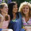 Outdoors female friends enjoying together. — Stock Photo