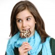 Young woman eating chocolate chip lollipop — Stock Photo
