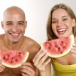 Young couple eating watermelon - Stock Photo