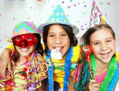 Three funny carnival kids portrait enjoying together. — Stock Photo