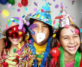 Three funny carnival kids portrait enjoying together. — Stok fotoğraf