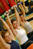 Young Women doing fitness exercise with a hand weights. — Stock Photo