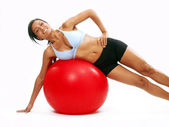 Young Woman doing fitness exercise with a red ball. — Stock Photo