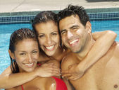 Young latin couple at swimming pool — Stock Photo