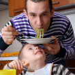 Father and his son eating — Stock Photo