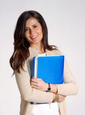 Beautiful young woman holding holding a blue folder. — Stock Photo