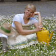 Mid adult woman gardening.Watering plants. - Stock Photo