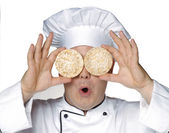 Funny chef holding two rice cracker glasses — Stock Photo