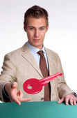 Young businessman giving a key — Stock Photo