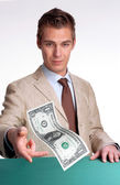 Young businessman agent giving one dollar bill. — Stock Photo