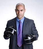 Bald head businessman using boxing gloves. — Stock Photo