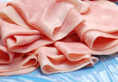 Prosciutto ham slices detail.Slices of ham. — Stock Photo