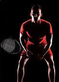 Siyah arka plan üzerine tenis oyuncusu. — Stok fotoğraf