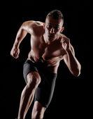 Running man on black background. — Stock Photo