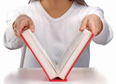 Young woman opening a red book. — Stock Photo