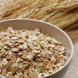 Free ears of wheat and wheatgerm in a small bowl — Stock Photo