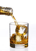 Pouring whisky drink and ice cube — Stock Photo