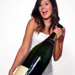 Happy bride holding a big champagne bottle — Stock Photo