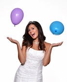 Happy bride celebrating with party balloons — Stock Photo