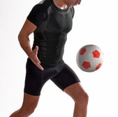 Soccer player kicking soccer ball — Photo