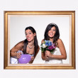 Funny brides inside a wood frame. — Stock Photo