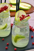 Lemon cocktail drinks and forest fruit — Stock Photo