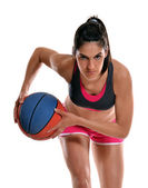 Young woman playing basket ball — Stock Photo
