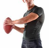男子手持一个橄榄球球 — 图库照片