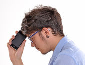 Unhappy man with phone — Stock Photo
