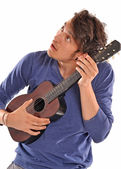 Young man holding  guitar. — Stock Photo