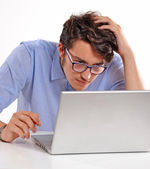 Worry businessman with laptop — Stock Photo