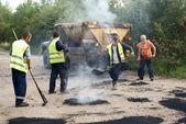 Patching repair dirt road — Stock Photo