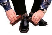 The man cleans boots — Stock Photo