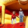 Children on an inflatable attraction — Stok fotoğraf