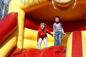 Children on an inflatable attraction — Stock Photo