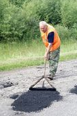 Repair of asphalt blade road — Stok fotoğraf