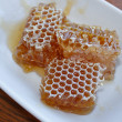 Honeycomb in plate — Stock Photo
