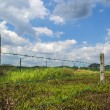 Fence with electrical line — Stock Photo