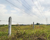 Fence with electrical line — Foto Stock