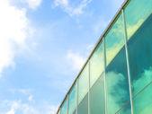 Cloud and glass building — Stok fotoğraf