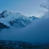 Low clouds near the Bezengi Wall — Stock Photo